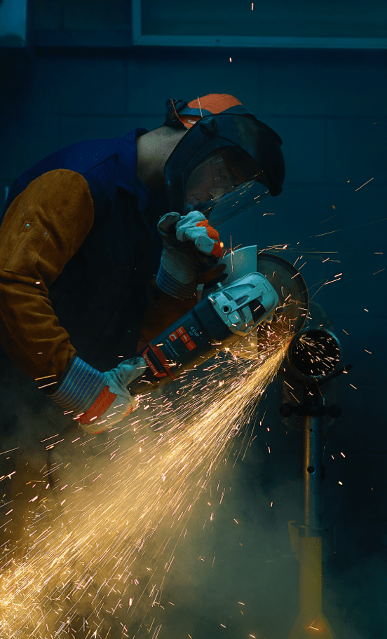 A Union Employee Cutting Metal