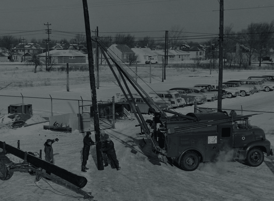Workers drilling at a work site.