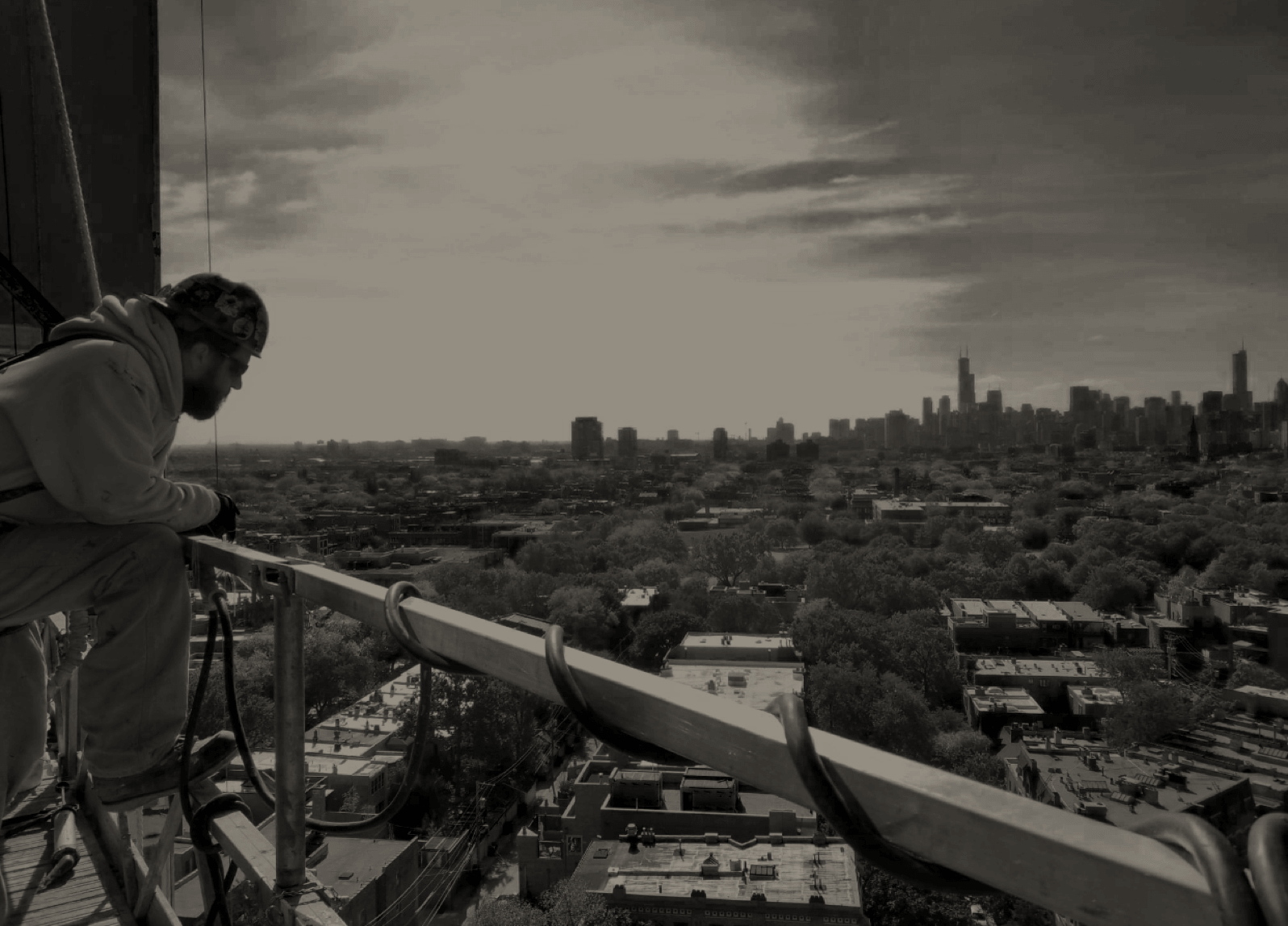 Construction Worker on a Building Site Overlooking a Skyline